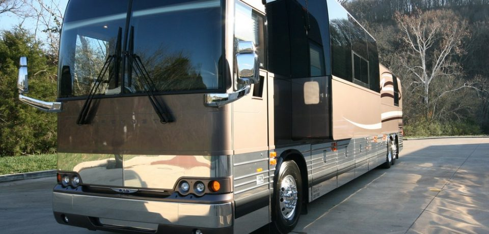 Get to know the benefits of hiring motor coach buses for travel
